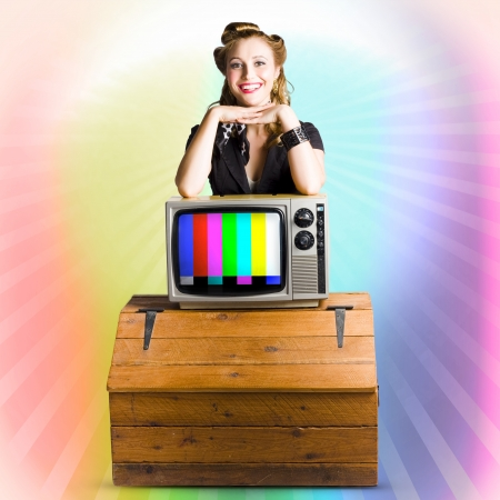 Sixties Vintage Sales Woman Resting On A Brand New Color TV Set Stock Photo - 17160787