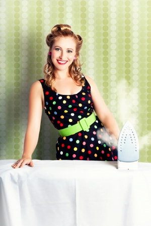 Fifties Classic Portrait Of A Retro House Work Woman Doing Home Choirs With A Old-Fashioned Steam Iron Stock Photo - 17160810