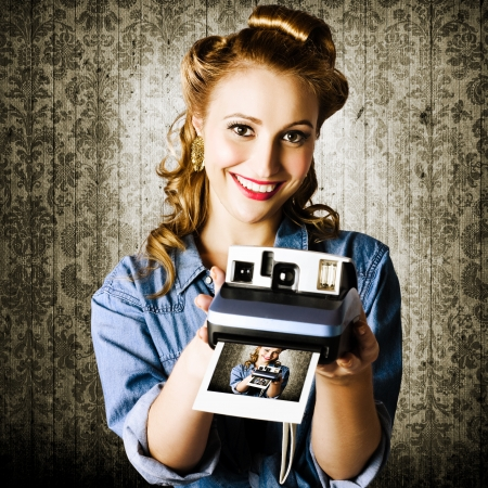 Young Retro Woman Holding A Instant Polaroid Camera While Displaying Her Creative Self Portrait Photo photo