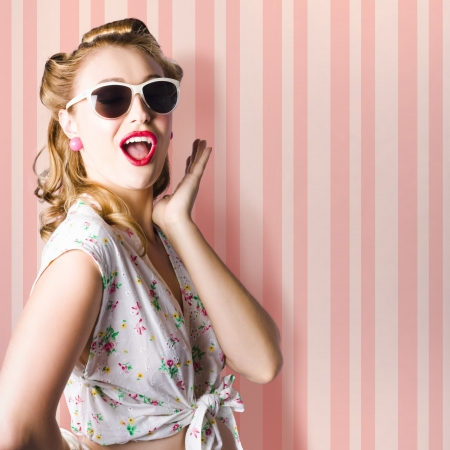 Surprised Young Woman With Pinup Hair Style And Makeup Posing In Striped Copy Space Retro Studio photo