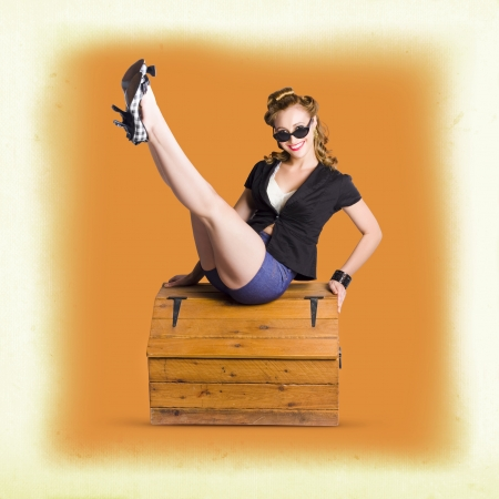 Beautiful Blonde Vintage Pinup Fashion Model Lifting Long Legs To Display Trendy Retro Shoes photo