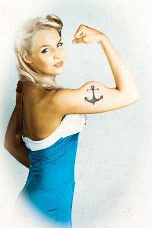 Tough American Style Maritime Pin-Up Girl With Big Muscles And Anchor Tattoo  photo
