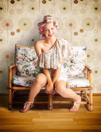 Beautiful Blond Pin-up Girl Smiling While Getting New Curly Hairstyle At Retro Hairdresser photo