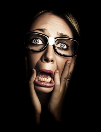 Dark Photograph On The Scared Face Of A Business Person Wearing Eye Glasses In A Depiction Of Stress And Fear photo