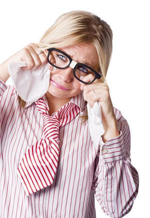 Isolated Studio Shot Of A Sad Young Business Woman Wearing Nerd Glasses Holding Two Tissues In Her Hands As She Bellows Tears Of Sorrow Stock Photo - 17160788