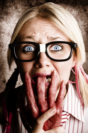 Nervous And Terrified Business Woman Chewing On A Dead Rotten Hard In A Depiction Of A Shock Horror Nail Biter Stock Photo - 17160758