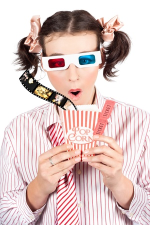 Attractive Young Girl With Comical Expression Watching 3D Comedy Movie Wearing Three Dimensional Glasses While Holding A Carton Of Popcorn With Box Office Entry Tickets photo