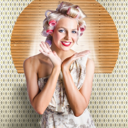 Smiling Stylish Vintage Blonde Woman In An Off The Shoulder Summer Dress Standing In A Classic Hairdresser With New Retro Hair Style In Large Hair Curlers photo