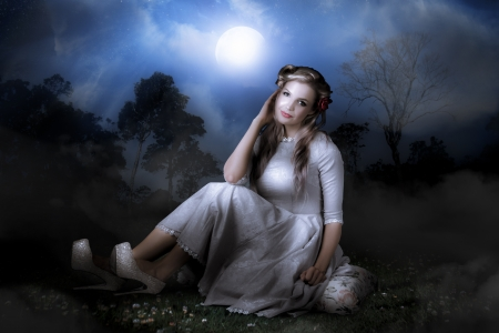 Photo Of A Beautiful Woman Sitting In A Mysterious Night Forest With Fog Stock Photo - 17383295
