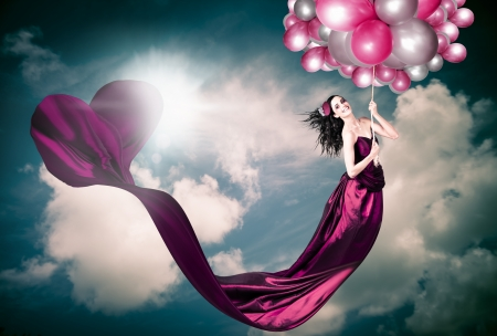 Valentines Day Photograph Of A Smiling Beautiful Retro Girl Hanging From The Sky With Draping Heart Shaped Dress In A Depiction Of Fashion Love Stock Photo - 17501694
