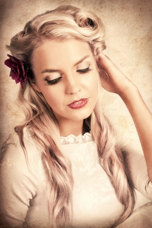 Forties Era Classic Portrait With Texture Of A Posing Vintage Blond Beauty In Elegant Frill And Lace Dress photo