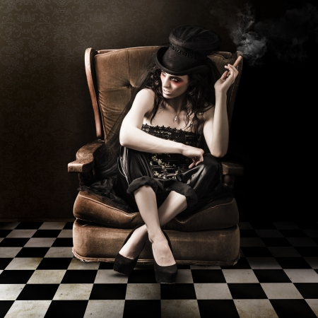 Fine Art Photo Of A Young Fashion Lady Sitting On Vintage Sofa In Grunge Interior photo