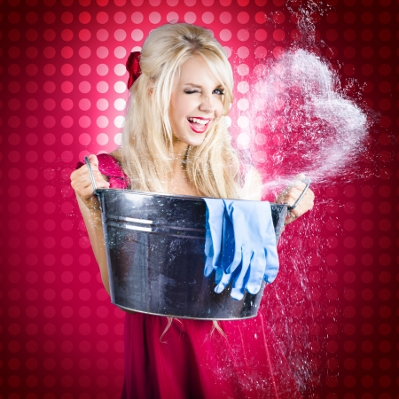 Funny Romantic Blond Pin Up Woman Holding Bucket Full Of Water When Splashing Out A Heart Shape With Cleaning Products In A Depiction Of Housekeeping Love photo