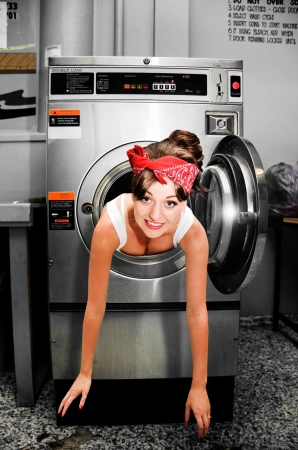 House Work Help Sees A Funny And Humorous Home Cleaning Woman Caught Stuck and Trapped Inside A Clothes Dryer When Doing House Choirs photo