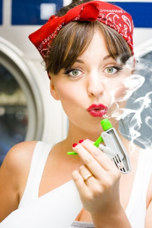 Killer Cleaning Lady Kills Germs In Style While Puffing On The End Of A Smoking Spray Bottle In A Funny And Humorous House Clean Concept Stock Photo - 18253672