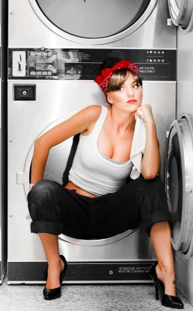 Dreaming Cleaning Lady Sits In A Washing Machine Thinking In Wonder About The Vision Of A Bigger Brighter Future For She Is A Cleaning Lady With A Dream photo