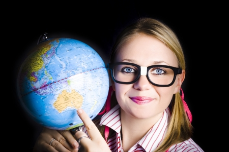 Geography student pointing to melbourne australia on a world globe when discovering places and regions on planet earth Stock Photo - 18253616