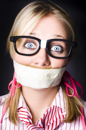 Shocked Geeky Nerd Traumatised During A Hostage Siege Whilst Being Kept Quiet With Taped Mouth photo