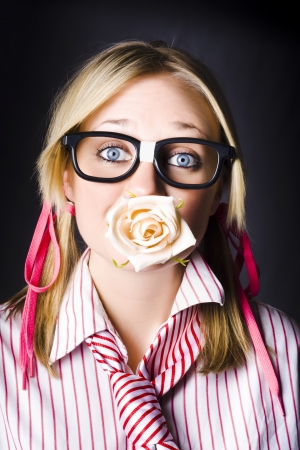 Silenced Nerd With Expression Of Admiration Holding Cream Rose Flower Bud In Mouth When Professing Untold Love Stock Photo - 18353122