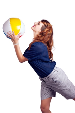 Isolated Picture Of A Playful Brunette Woman Throwing Colourful Beach Ball In A Summer Fun Concept photo