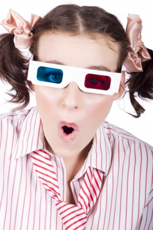 Excited person wearing 3D glasses, surprised with open mouth over whiite background photo