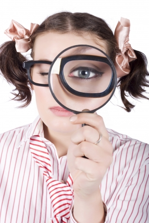 Young caucasian businesswoman wearing eyeglasses looking with one eye through magnifying glass Stock Photo - 18521663