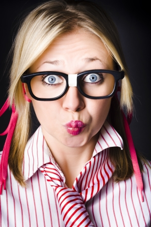 Funny face portrait of an intellectual businesswoman with shocked expression, thinking with pouted lips on dark background Stock Photo - 18574426