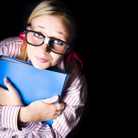 Cute geeky school student holding educational book on black copyspace background Stock Photo - 18574433