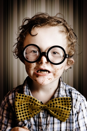 Funny candid portrait of a little nerd boy full as a goog from eating too much easter chocolate  Stock Photo - 18629222