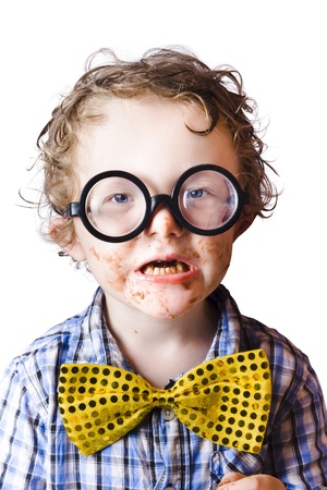 Portrait of funny boy with large black rimmed spectacles and with his face covered in chocolate Stock Photo - 18767606