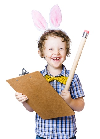 Happy young boy in rabbit ears writing Easter list with large pencil, white background Stock Photo - 18767574