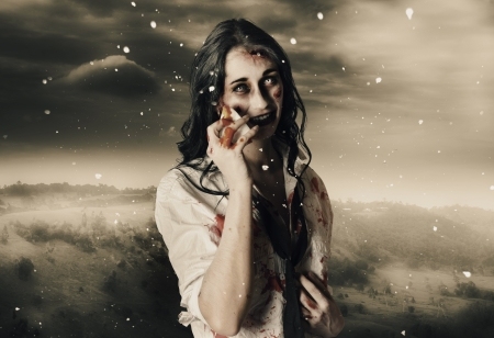 Deadly blizzard of falling snow pouring down on a dead female zombie crying tears of pain Stock Photo - 18788081