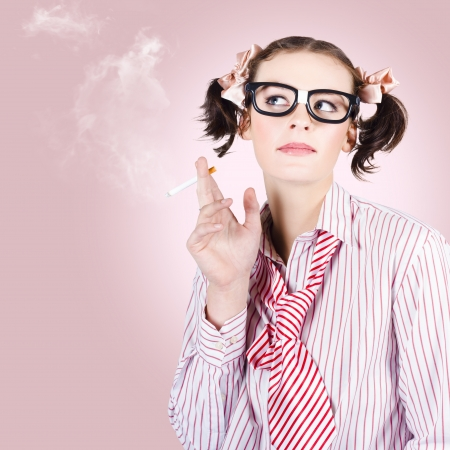 Geek in stress smoking cigarette on pink copyspace in a smoke break concept Stock Photo - 18787938