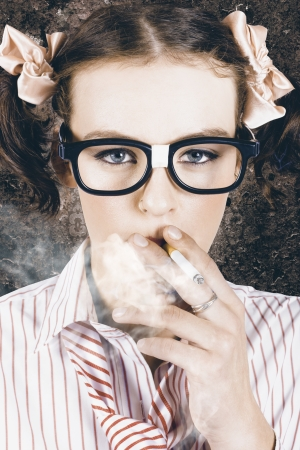 Edgy grunge portrait of a hipster nerd smoking cigarette in a depiction of cool photo