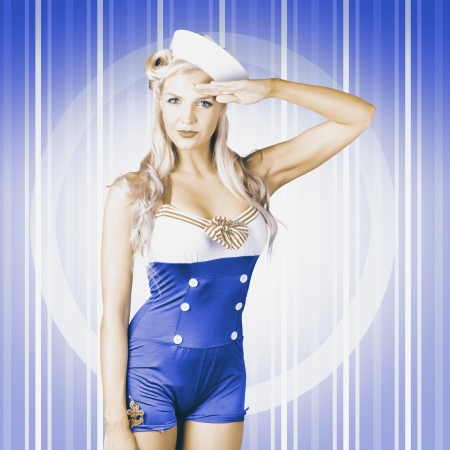 Retro photograph of a navy blue American sailor girl posing for a military salute on pinup blue stripes photo