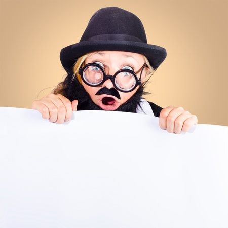 Excited senior business person wearing bowler hat and nerd spectacles holding blank white banner when advertising a special concession Stock Photo - 18792135