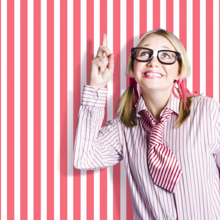 Excited retro sales woman pointing up to striped copy space when selling innovative products in a point of sale concept photo