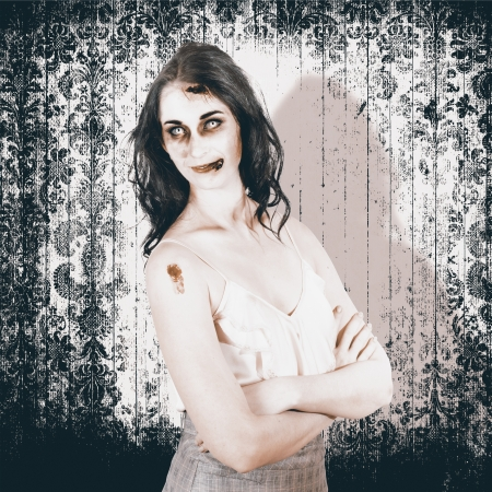 Old Fashion Halloween monster standing with arms folded on grunge wallpaper background in a vintage nightmare concept photo