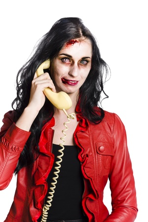 Smiling zombie woman talking on a retro corded telephone Stock Photo - 19062742