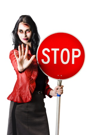 Zombie woman with red stop sign, dead end concept on white background photo
