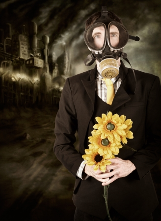 Photo illustration of a businessman wearing gas mask standing in industrial wasteland of smog and pollution holding sunflowers in a depiction of the carbon tax on climate change illustration