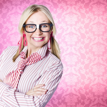 Funny portrait of a smart nerd businesswoman smiling with toothy grin on pink copyspace wallpaper Stock Photo - 19165398