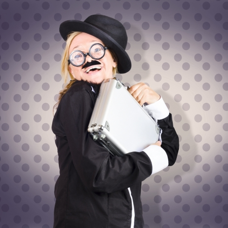 Image of a funny female character in suit showing work as fun when hugging briefcase tightly. purple dot backdrop Stock Photo - 19165209