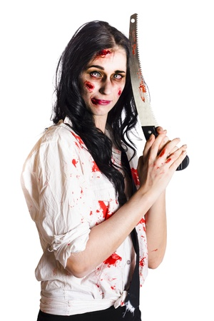 Zombie woman with wounds and blood stains holding a large knife with serrated edge isolated on white background photo