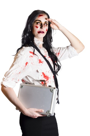 Blood splatter zombie businesswoman with case under arm looking into distance, danger concept on white background Stock Photo - 19145492