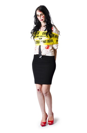 Dead blood covered woman stood with crime scene tape around body, white background photo