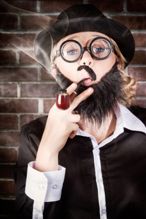 Funny prviate eye detective with wonky moe, fake beard, nerdy glasses and bowler hat smoking pipe at elementary (my dear watson) school Stock Photo - 19247579