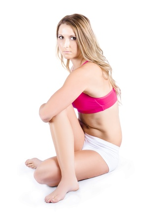 Attractive young woman warming up on white background photo