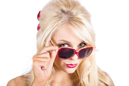 Portrait of beautiful young blond woman in retro sunglasses on white background photo