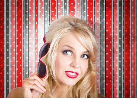 Face of a beautiful fashion girl thinking with fashionable retro accessory Stock Photo - 20097334